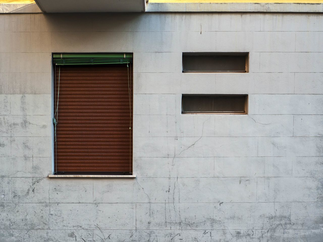 Architecture Brown Window Building Building Exterior Building Exteriors Built Structure Day Facade Building Facade Detail Home Exterior No People Outdoors Shade Stone Tiles Wall Window Window Frame Window Shade Windows Wome Window