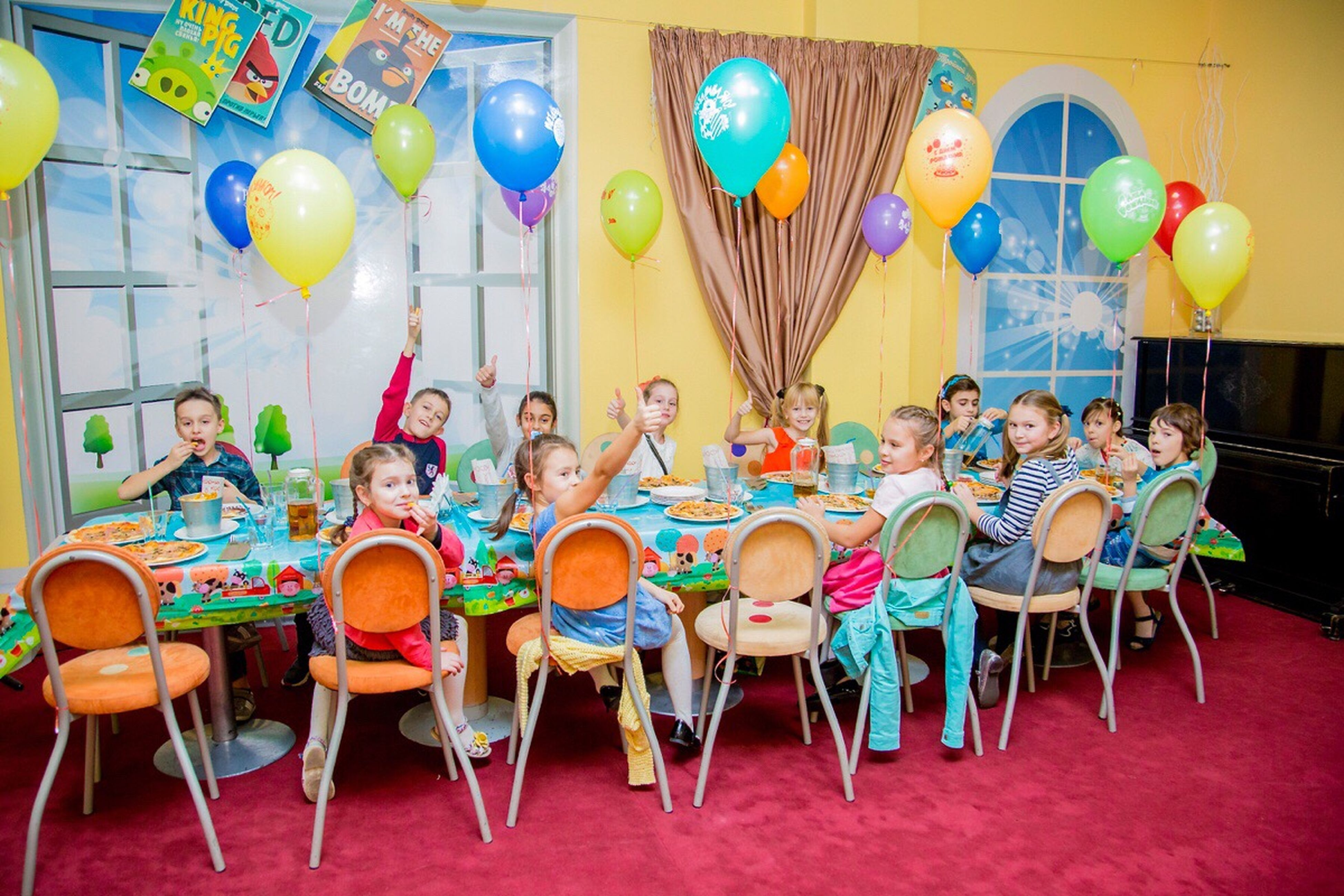 celebration, balloon, child, party - social event, sitting, togetherness, cheerful, smiling, people, full length, chair, large group of people, childhood, friendship, adult, indoors, young adult, day