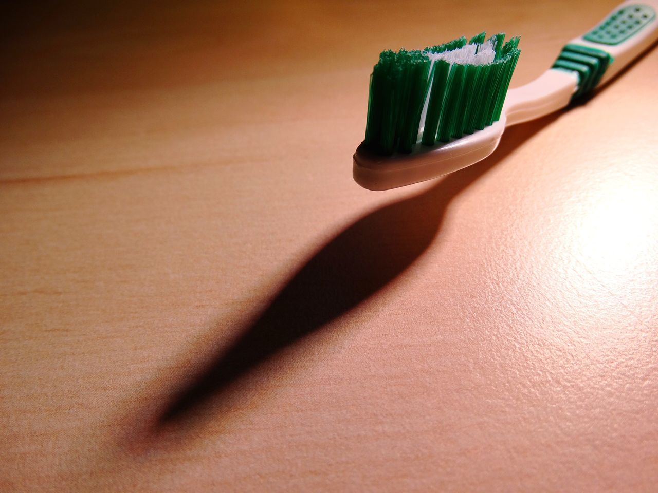Toothbrush and shadow. Shadow Indoors  Table No People Close-up Day Toothbrush Toothbrushes Shadows Dentist Clean Brush Brushing Teeth  Cleaning Teeth Teeth Hygiene Shadows & Lights Green Plastic Healthy Lifestyle Healthy Healthcare And Medicine Health