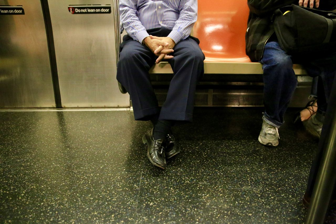 Adult Adults Only Airport Departure Area Business Businessman Commuter Train Day Indoors  Journey Legs Crossed At Knee Low Section Men One Person Passenger People Public Transportation Rail Transportation Real People Sitting Subway Train Train - Vehicle Transportation Waiting Well-dressed