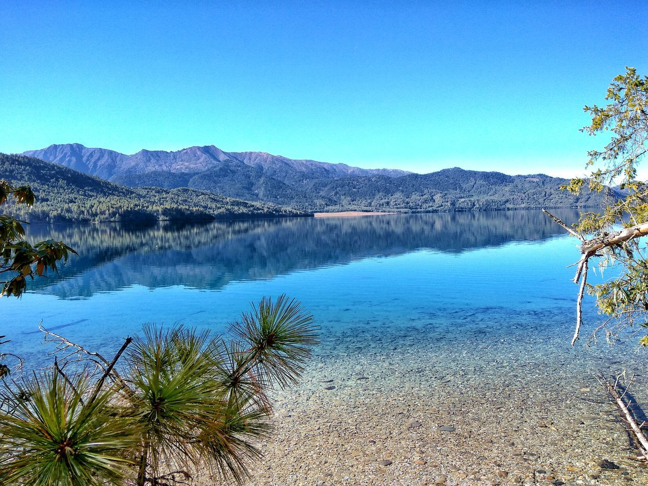 tranquil scene, blue, nature, tranquility, beauty in nature, scenics, mountain, clear sky, no people, day, lake, water, outdoors, mountain range, tree, sky