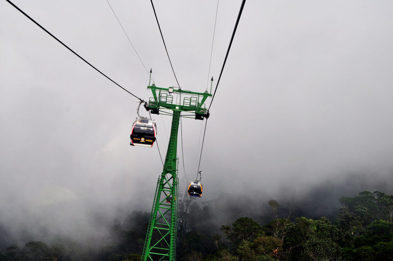 World's longest cablecar reaching above the clouds at Ba Na Hills, near Danang, Vietnam. Attractions Ba Na Hills Cablecars Cloud Danang Fog Fun Parks Going Up Mist Mountains Pylons Rides Tourism Transport Transportation Travel Vietnam Weather