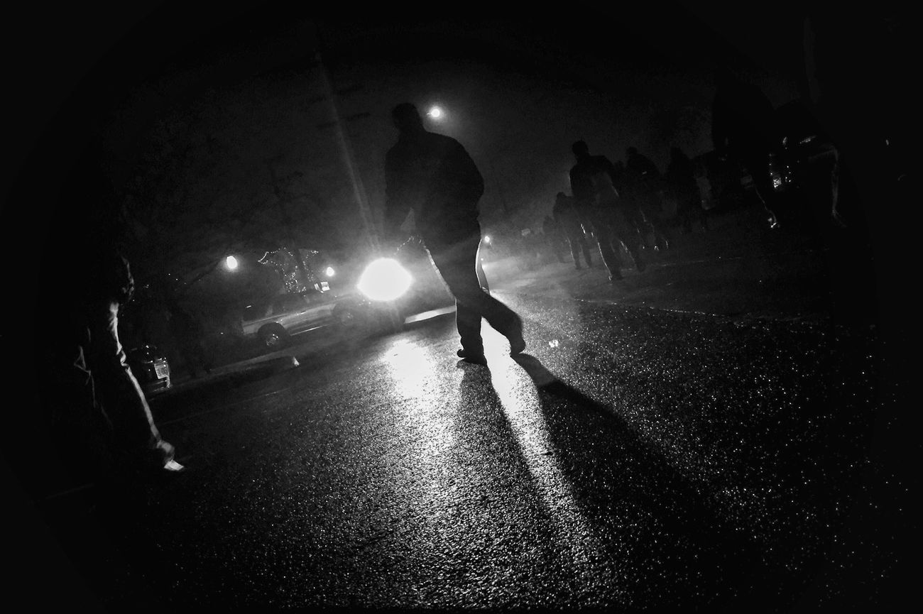 Friday night lights. Night Street Illuminated Real People One Person Road Full Length Rear View One Man Only Men Outdoors People Only Men Adult Photojournalism Reportage Streetphotography Shootermag