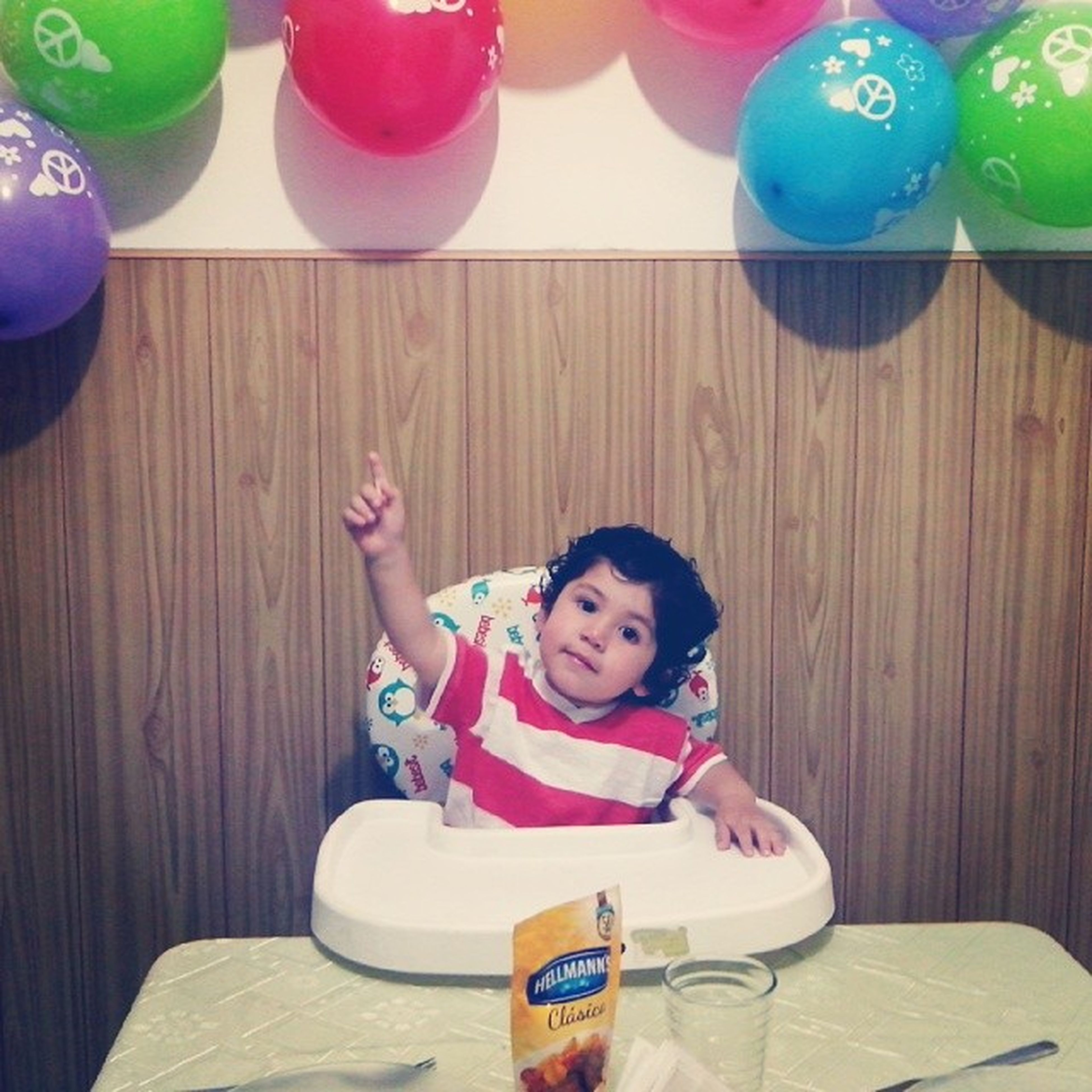childhood, elementary age, indoors, girls, innocence, person, cute, boys, leisure activity, lifestyles, table, happiness, casual clothing, smiling, high angle view, food and drink, looking at camera, portrait