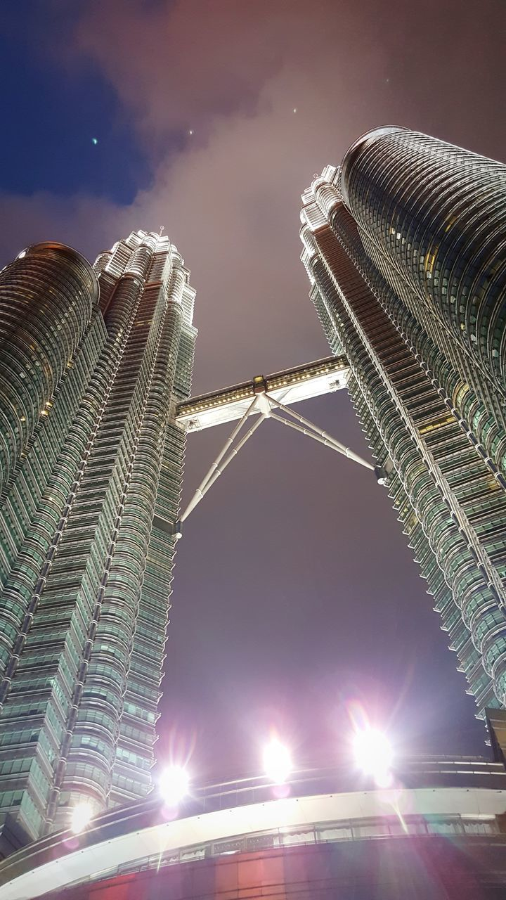 architecture, built structure, building exterior, lens flare, low angle view, sky, illuminated, outdoors, travel destinations, city, skyscraper, no people, night