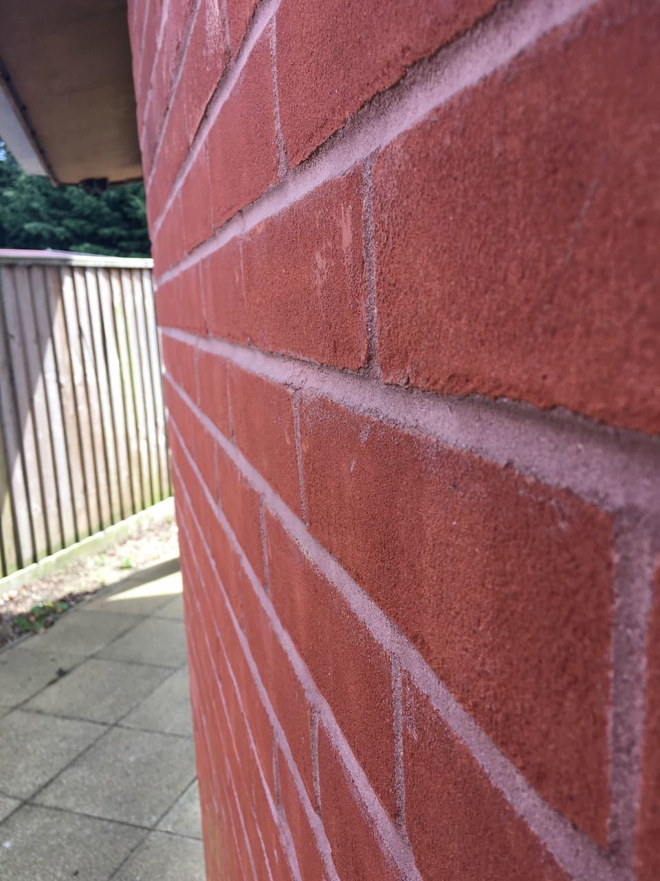 brick wall, day, built structure, architecture, outdoors, building exterior, red, no people, close-up, retaining wall, court