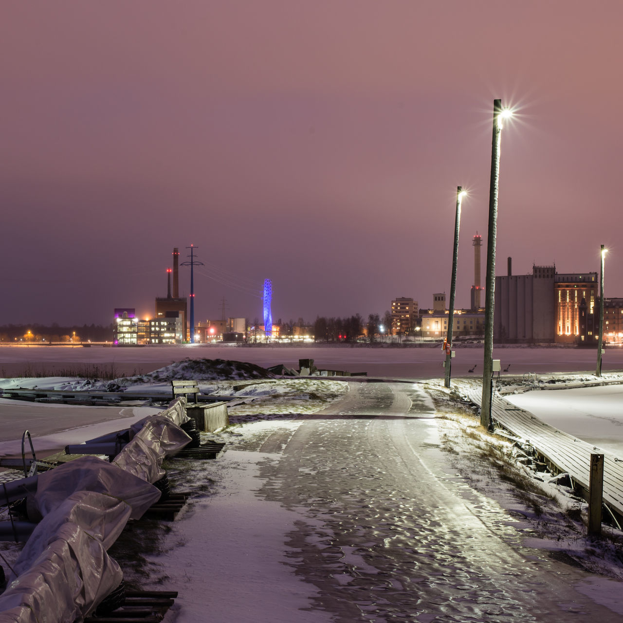 Wintery cityscape of Vaasa, Finland, as seen from a marina at Vaskiluoto island Architecture City Cityscape Cold Temperature Electricity Pylon Ice Landscape Night No People Power Plant Purple Sky Pylons Slippery Squarecrop Tower Urban Skyline Vaasa Winter
