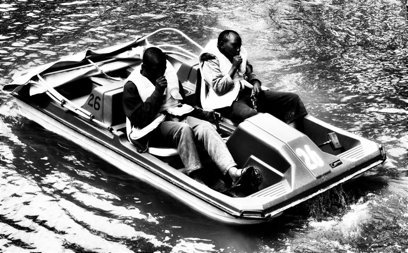 A couple of parking boys having a boat ride whiie sniffing glue. Travel Photography Nairobi Kenya Streetphoto_bw Streetphotography Monochrome Children Boats