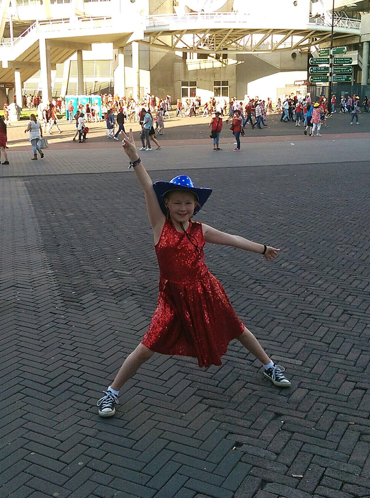 Dancing Girl Outdoors City Street Art Performance Red Dress Hat