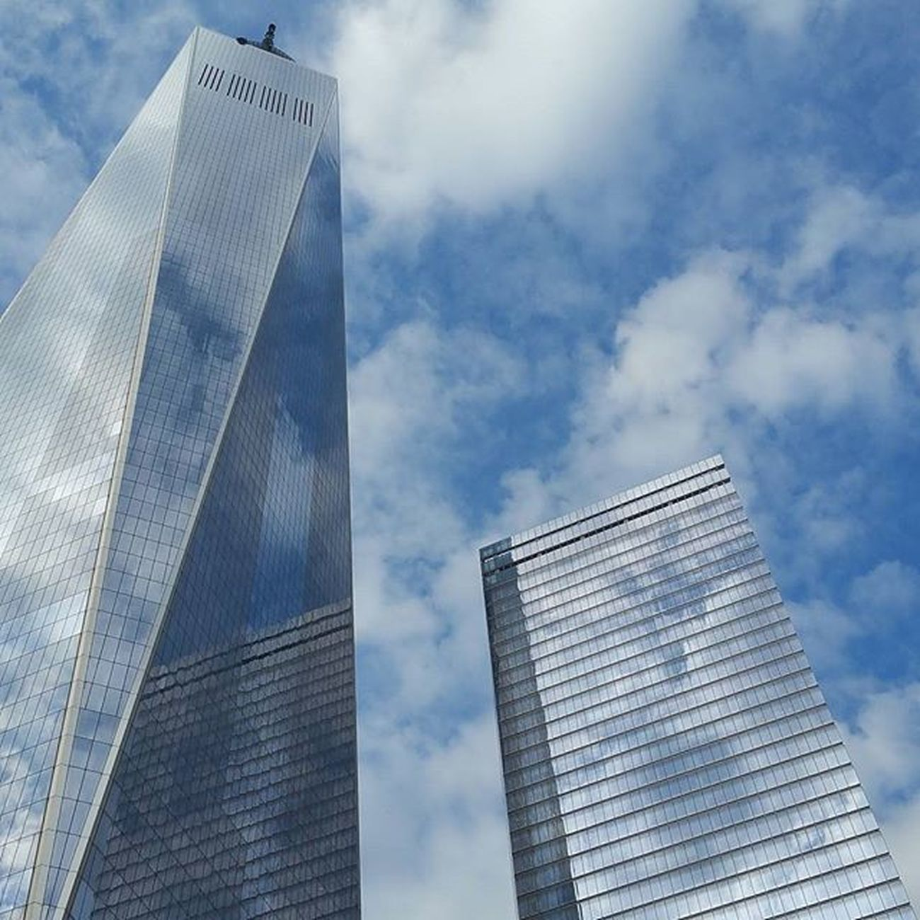 The Spire. ▫ Reflectiongram Moodygrams Urbangathering Reflection Agameoftones Manhattan Nycprimeshot Newyorkcity Imaginatones Downtown WTC Beautiful Architecture Buildings Imagine Create Inspire Photo Clouds Sky Clear Blue Resilience  Strength GroundZero