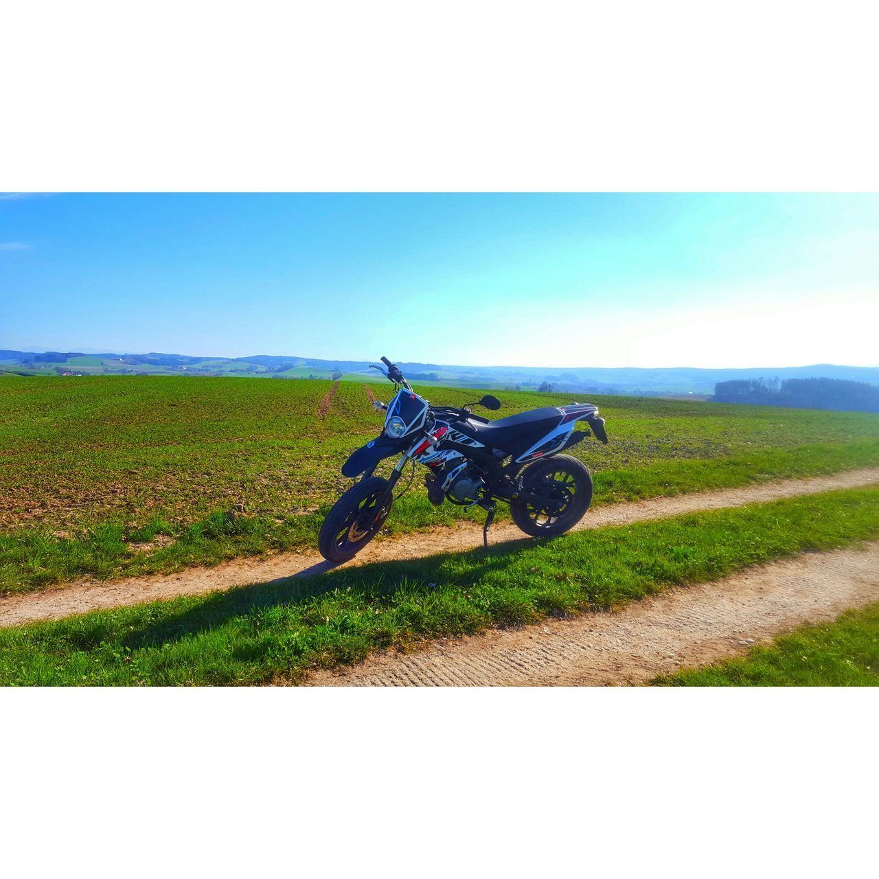 transportation, land vehicle, mode of transport, field, landscape, grass, motorcycle, horizon over land, day, off-road vehicle, sky, clear sky, outdoors, road, nature, real people, men, one person, people