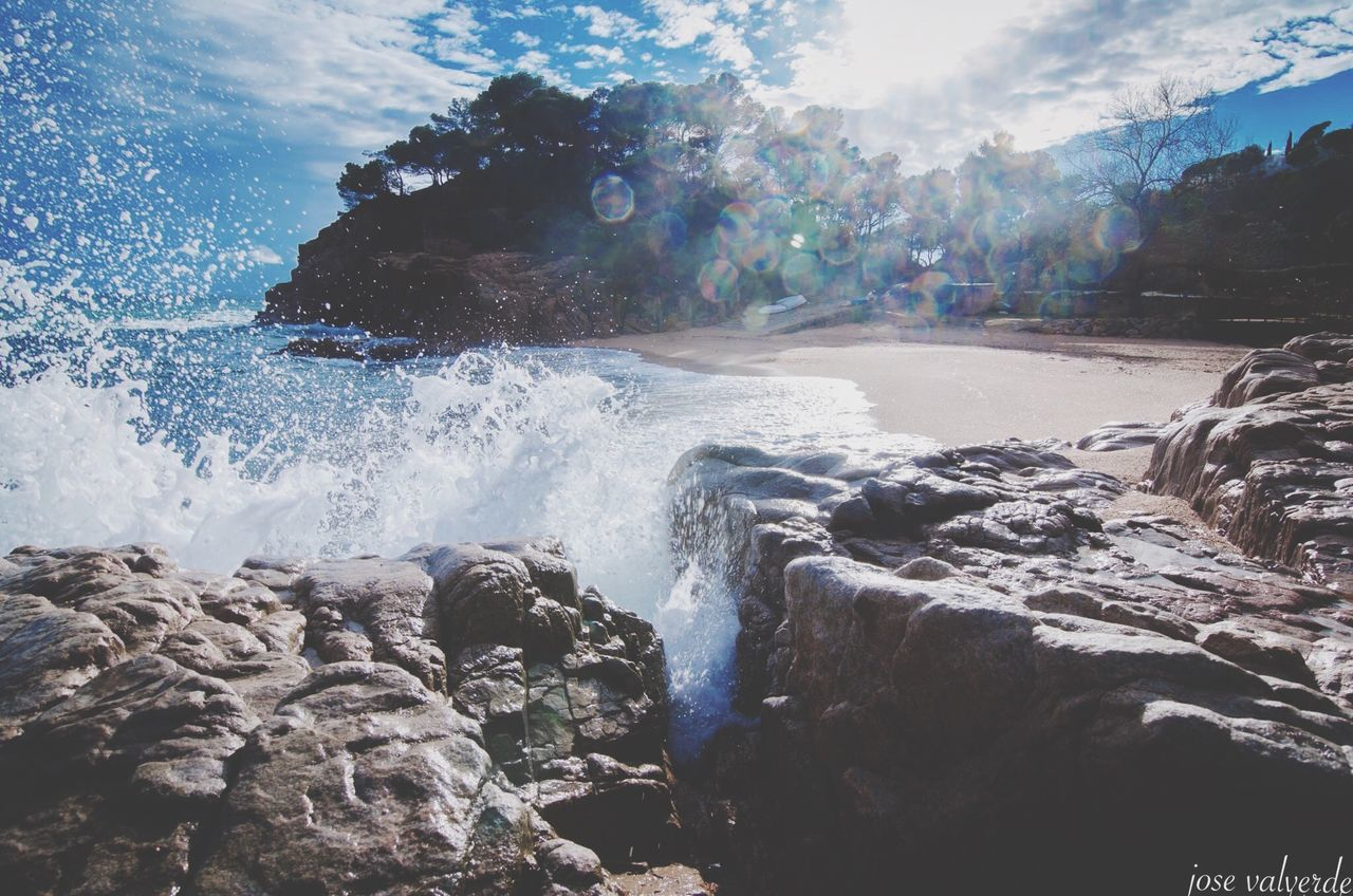 water, rock - object, nature, rock, sea, beauty in nature, motion, no people, outdoors, day, scenics, sky, wave, force, tree