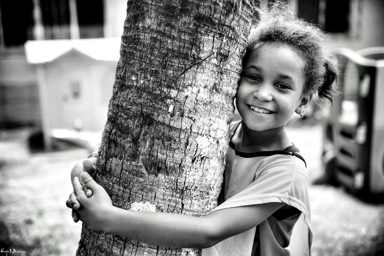 Child Portrait Smiling Girls Looking At Camera Children Only Childhood One Girl Only Happiness One Person Cheerful Fun Outdoors People Real People Happiness Freshness Children Photography Social Documentary School Life  Children Black And White Leisure Activity Social Photography Black & White The Portraitist - 2017 EyeEm Awards