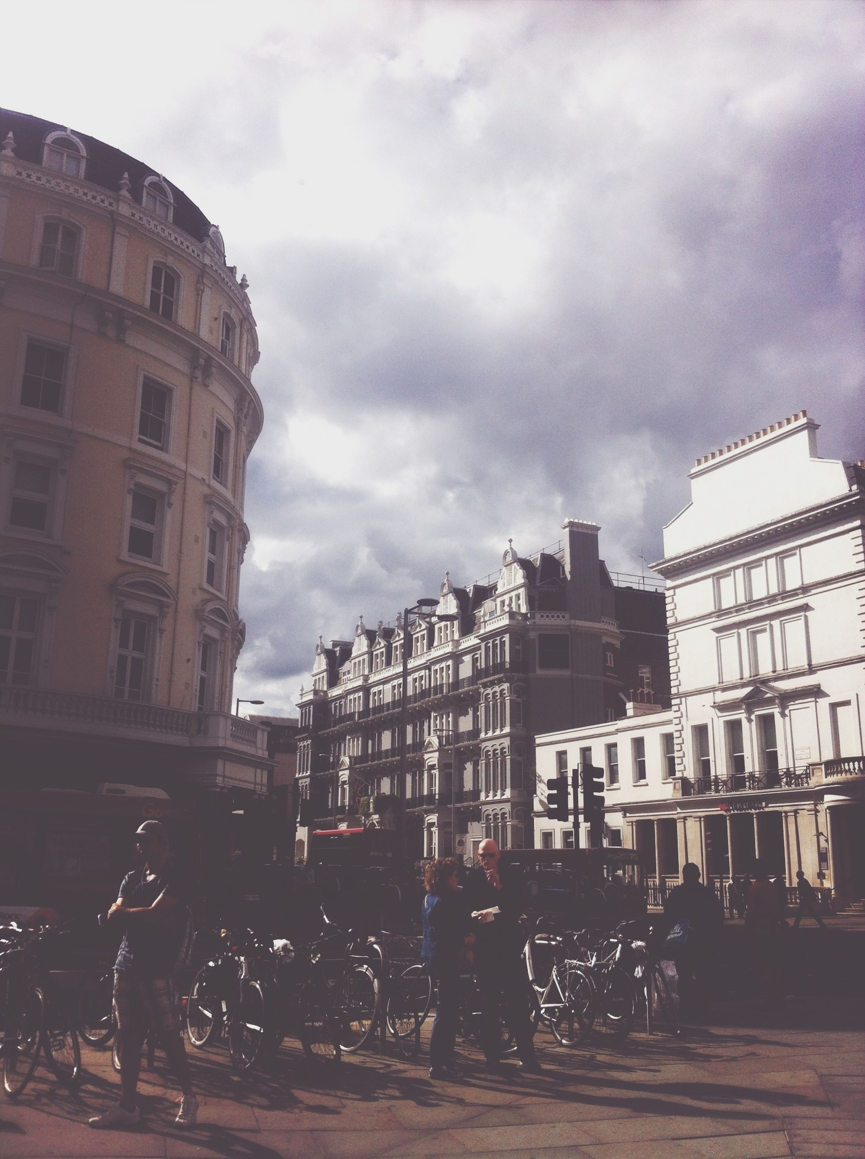 building exterior, architecture, built structure, sky, city, cloud - sky, building, cloudy, street, residential building, city life, residential structure, cloud, overcast, incidental people, day, window, outdoors, weather