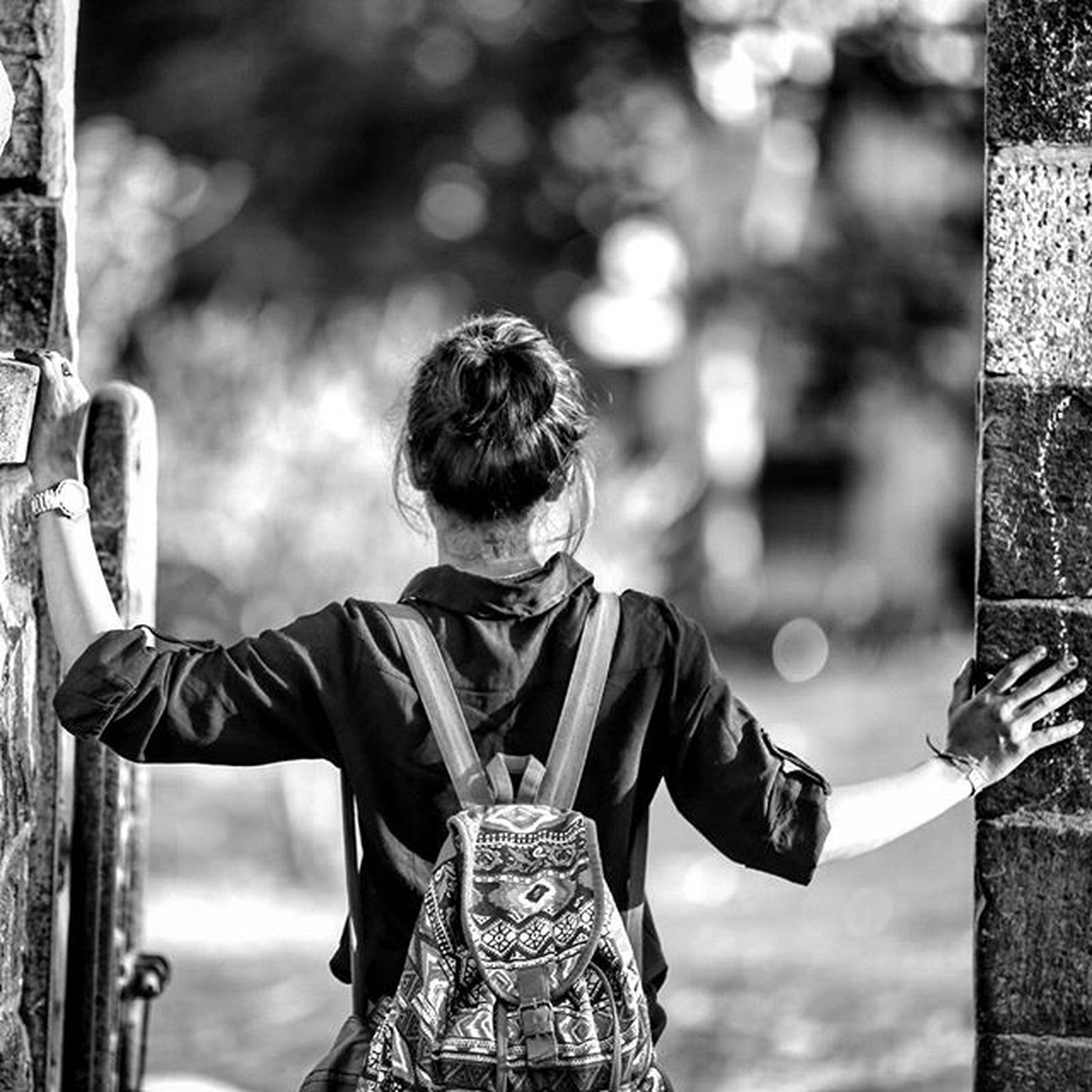 focus on foreground, lifestyles, art and craft, art, casual clothing, leisure activity, creativity, tree, day, outdoors, standing, holding, rear view, human representation, waist up, sculpture, park - man made space, childhood