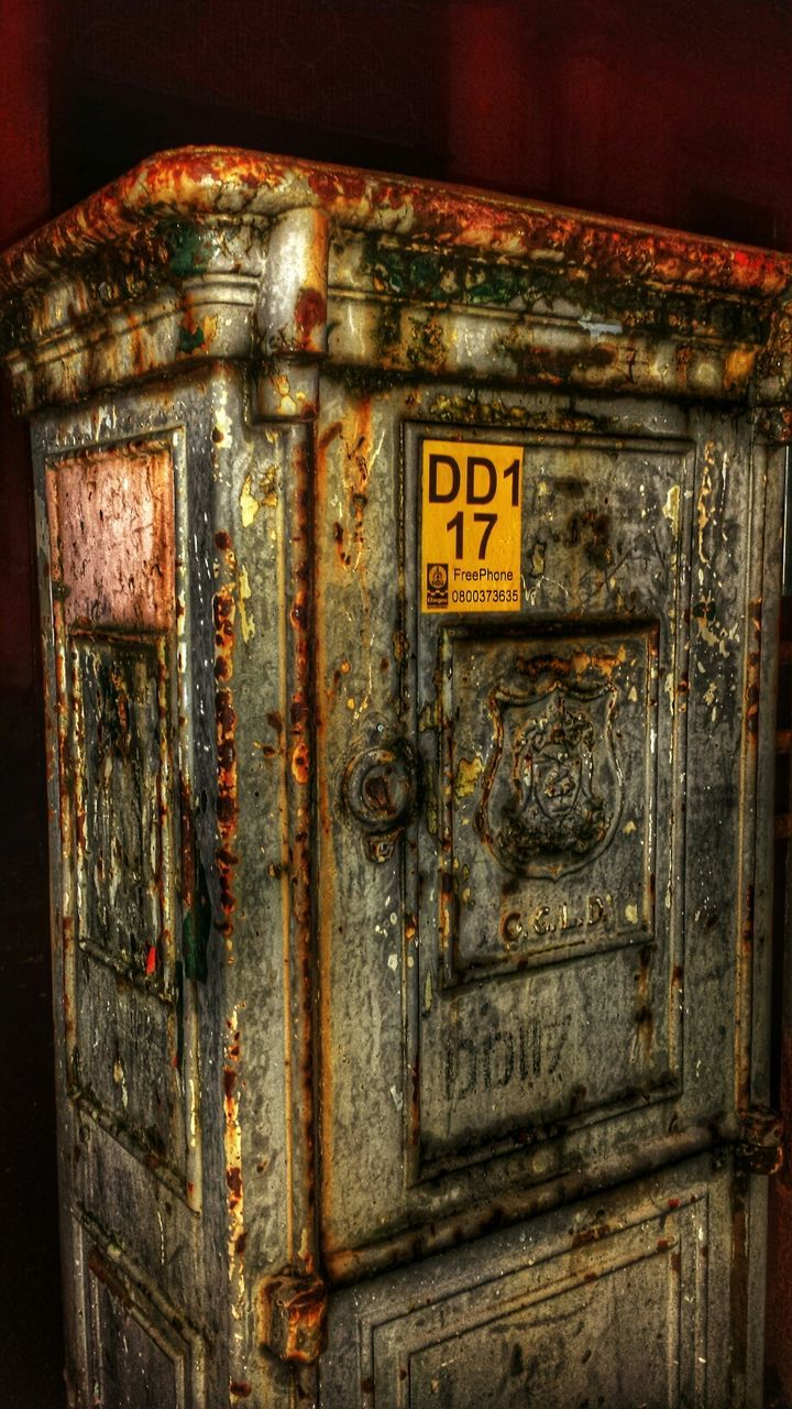 text, no people, close-up, communication, abandoned, indoors, rusty, day