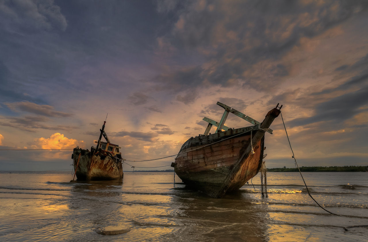 sea, sunset, sky, water, nature, nautical vessel, abandoned, transportation, damaged, waterfront, tranquility, cloud - sky, beauty in nature, no people, beach, scenics, outdoors, day