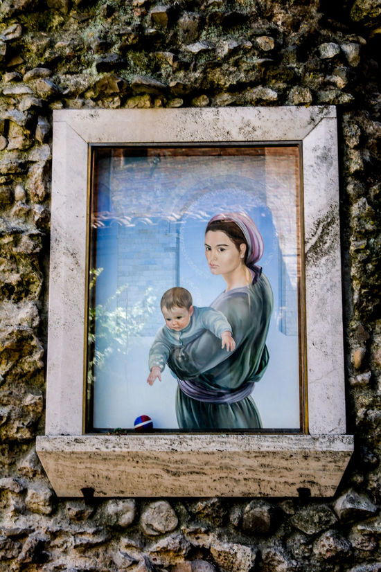 Mother and child painting, probably Madonna and Child in contemporary style. Street in Siena. Icon Religious Painting Adult Bonding Care Child Childhood Contemporary Day Females Girls Love Low Angle View Madonna And Child Mother Mother And Child Outdoors Parent Real People Religion Togetherness Veneration