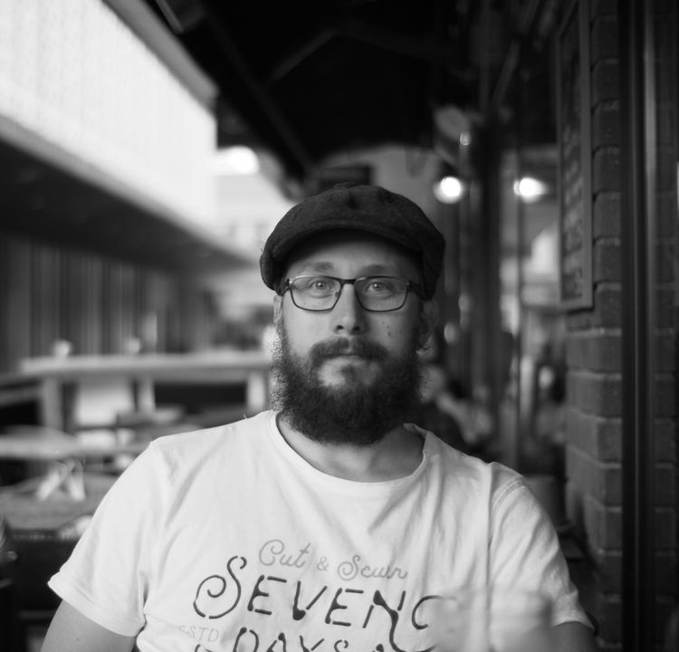 One Man Only Only Men Eyeglasses  Blackandwhitephotography Adults Only One Person Beard Adult Text Blackandwhite Casual Clothing Focus On Foreground Portrait People Cap Day Outdoors City Young Adult EyeEm Selects ThatsMe Voigtländer OlympusPEN Olympus Voightlander Nokton 25mm F1:0,95