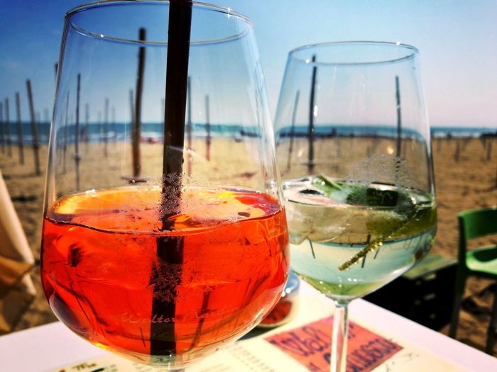 A drink at the beach Food And Drink Beach Day Wineglass Ice Cube Cocktail Drink Alcohol Sky Outdoors Refreshment No People Lido Di Jesolo Italy🇮🇹