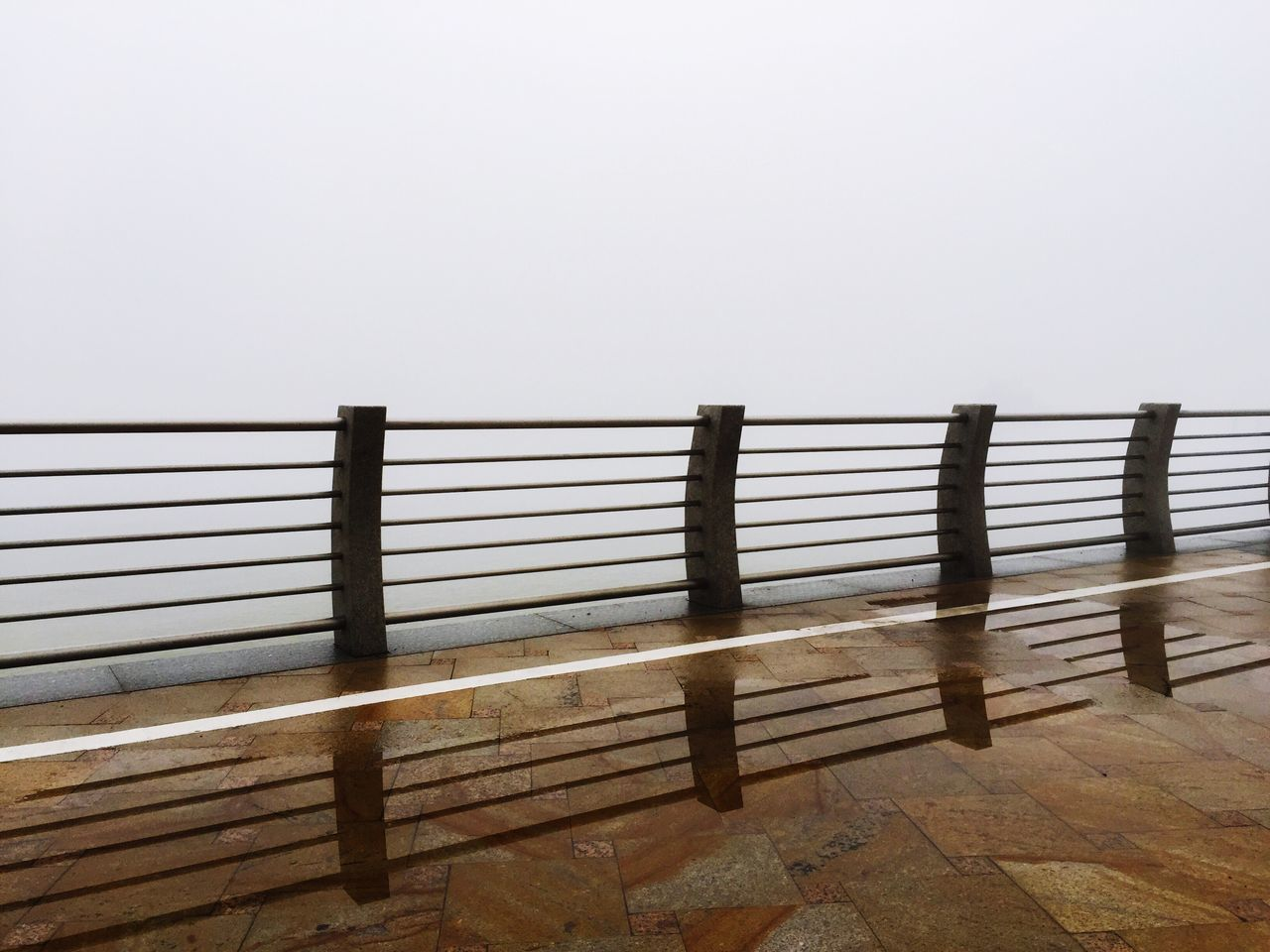 Learn & Shoot: Balancing Elements Reflection Reflections Fog Foggy Morning Foggy Railing Balance Pavement Water Water Reflections Lonely Endlessness China Zhuhai Leading Lines Fine Art Photography