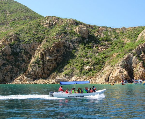 Cabo San Lucas Mexico Nautical Vessel Mountain Large Group Of People Vacations Travel Destinations Adventure Water River Travel Glass Bottom Boat Outdoors Blue Sky Leisure Activity Oar Nature Day Adult Togetherness Scenics Aquatic Sport
