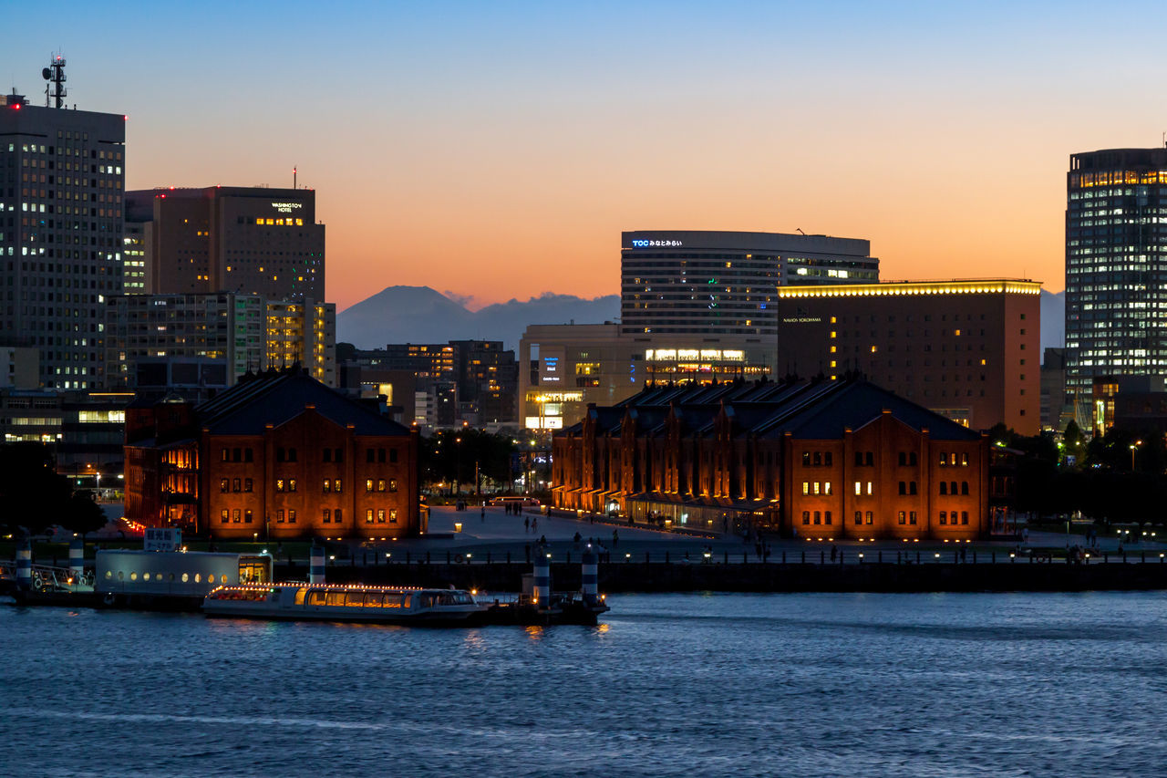The Yokohama skyline at dusk Architecture Building Building Exterior Built Structure Cities At Night City City Life Cityscape Eye4photography  EyeEm Best Shots Illuminated Modern No People Office Building Outdoors Sky Sunset Taking Photos Tall - High Travel Destinations Traveling Urban Skyline Water Waterfront