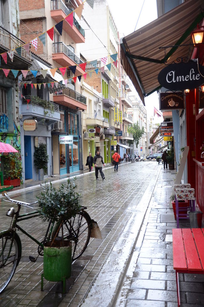 Alley Architecture Bicycle Building Building Exterior Built Structure Carnival City City Life Day Diminishing Perspective Market Narrow Outdoors Rain Rainy Rainy Days Residential Building Residential Structure Sidewalk Sidewalk Cafe Sky The Way Forward Town Vanishing Point