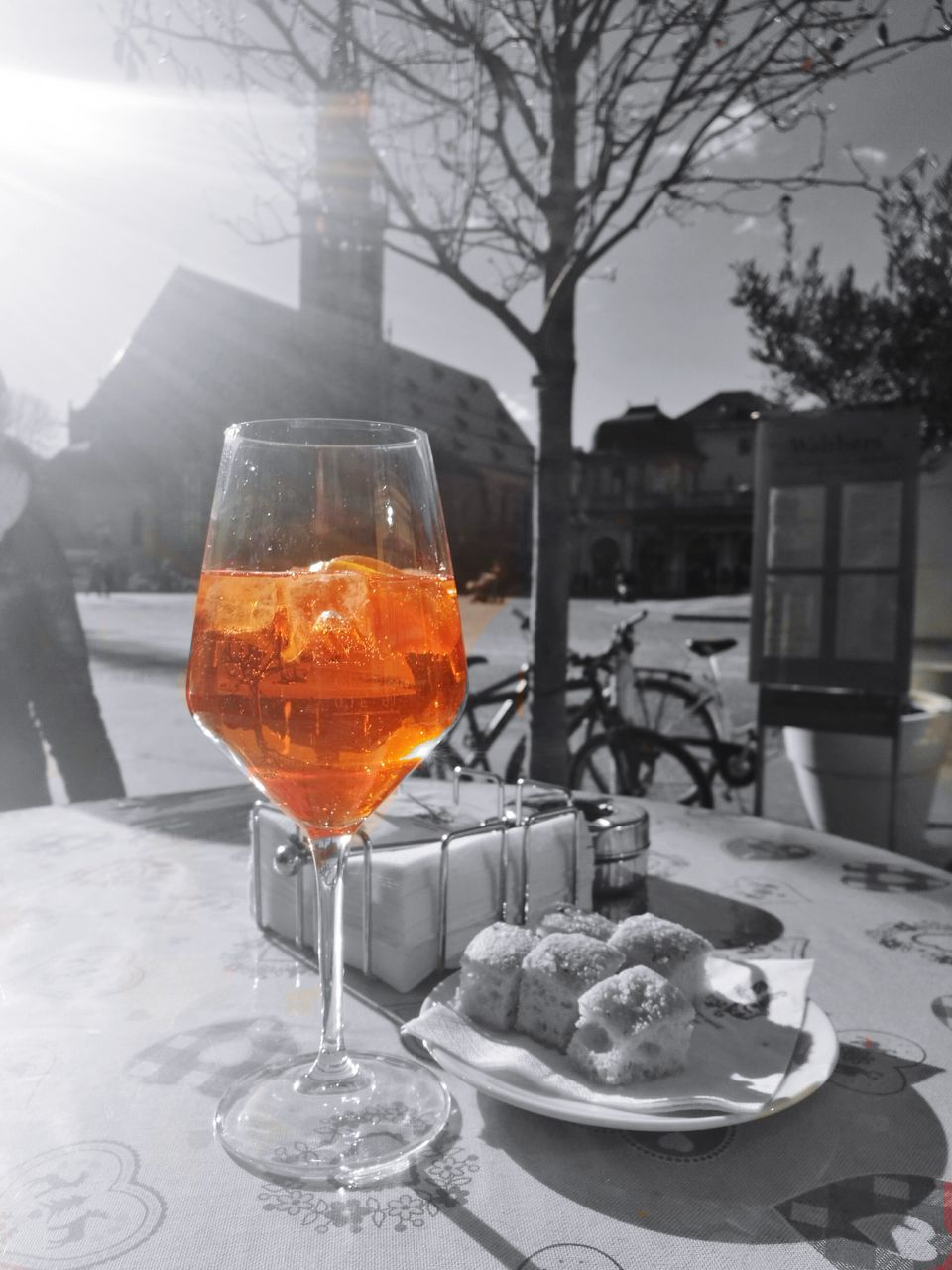 drinking glass, food and drink, table, wineglass, outdoors, drink, cold temperature, focus on foreground, architecture, building exterior, alcohol, no people, refreshment, winter, plate, wine, built structure, tree, food, close-up, day, freshness, sky, ready-to-eat