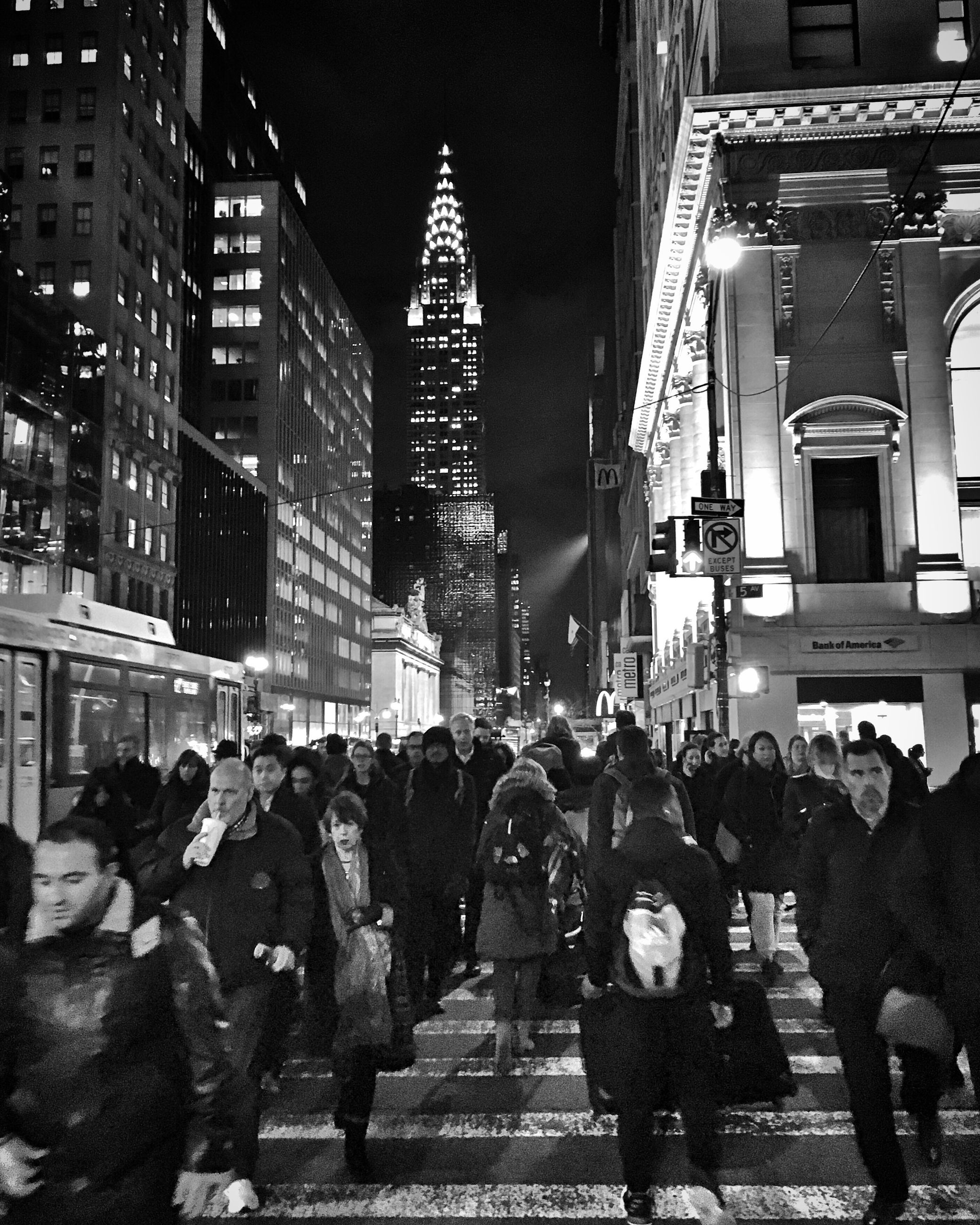 large group of people, city, travel destinations, travel, skyscraper, walking, architecture, adults only, illuminated, building exterior, crowd, night, people, men, outdoors, adult, only men