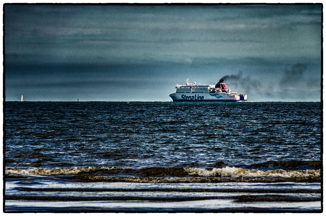sea, nautical vessel, transportation, water, horizon over water, cloud - sky, sky, nature, outdoors, mode of transport, day, ship, sailing, beach, wave, no people, scenics, beauty in nature, ferry, storm cloud, oil pump