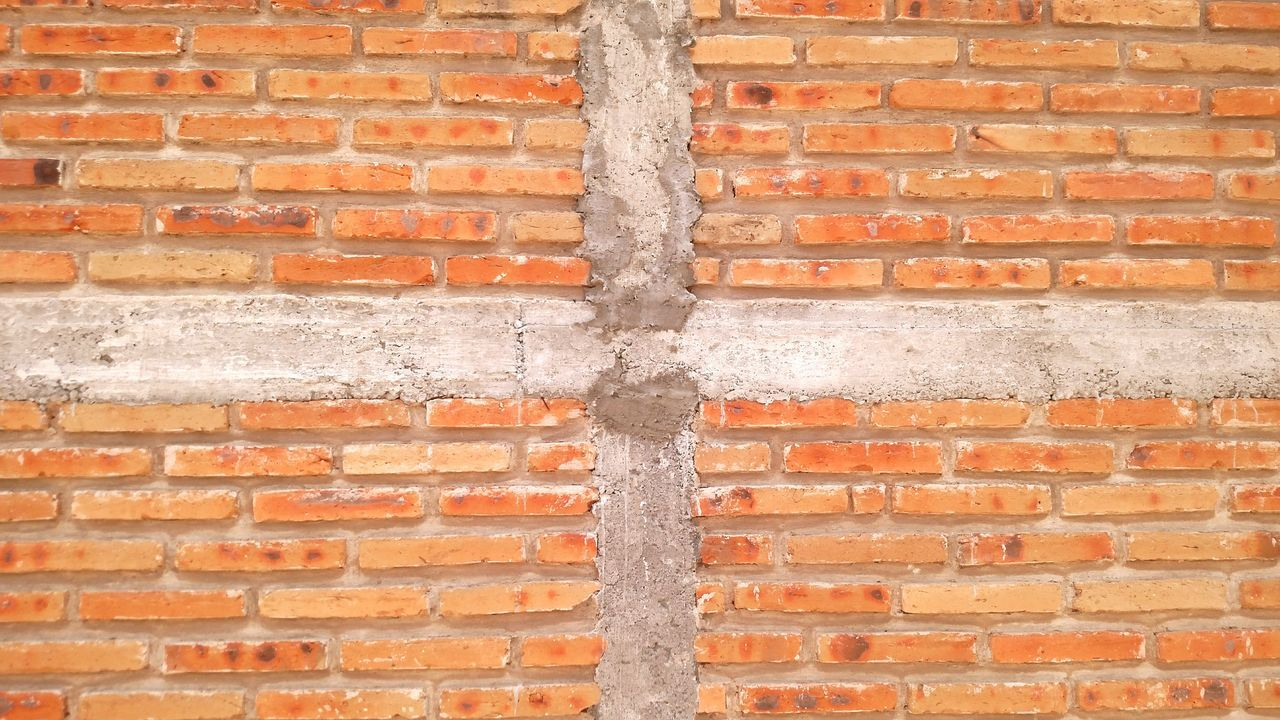 The wall Brick Wall Wall - Building Feature Full Frame Backgrounds Built Structure Architecture Day Pattern Outdoors No People Textured  Building Exterior Close-up