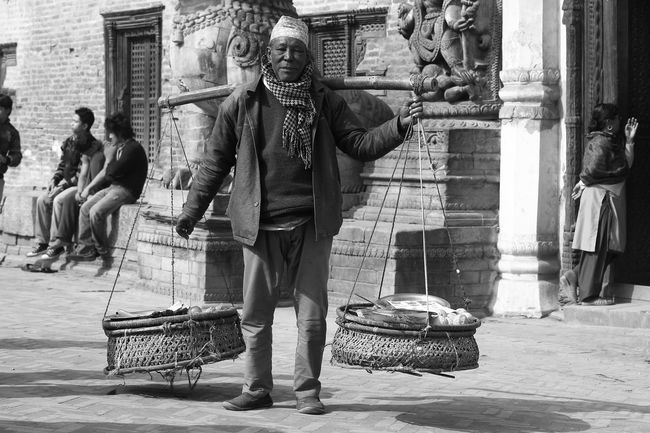 Balancing Balancing Act Balancing Elements Balancing Out The Lows Casual Clothing City Life Contemplative Daily Business  Getting In Touch Getting Inspired Hard Work Hard Working Lifestyles Nepali  Nepali People Portrait Of A Man  The Portraitist - 2016 EyeEm Awards The Week On Eyem The Street Photographer - 2016 EyeEm Awards Feel The Journey Natural Light Portrait The OO Mission On The Way Hidden Gems