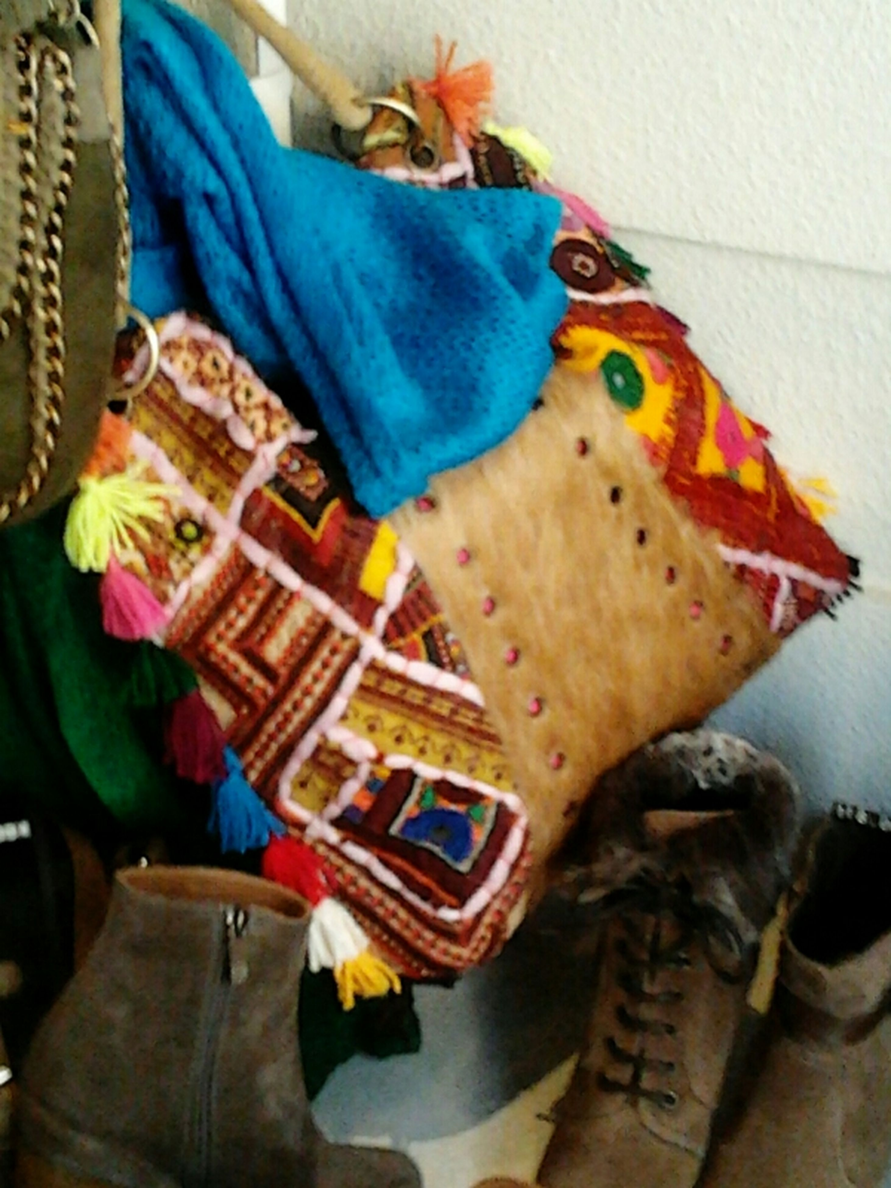 indoors, high angle view, fabric, close-up, textile, unrecognizable person, men, home interior, holding, food, multi colored, one animal, animal representation, day, lifestyles, food and drink, clothing