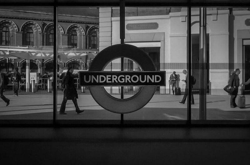 Architecture Building Exterior Built Structure Window Walking Street Text Glass - Material Transparent City Life Battle Of The Cities EyeEm Best Shots EyeEmBestPics The EyeEm Collection EyeEm Gallery Londonlife LONDON❤ London New Talents Capital Cities  London Underground Tube In Front Of Monochrome Photography London Lifestyle