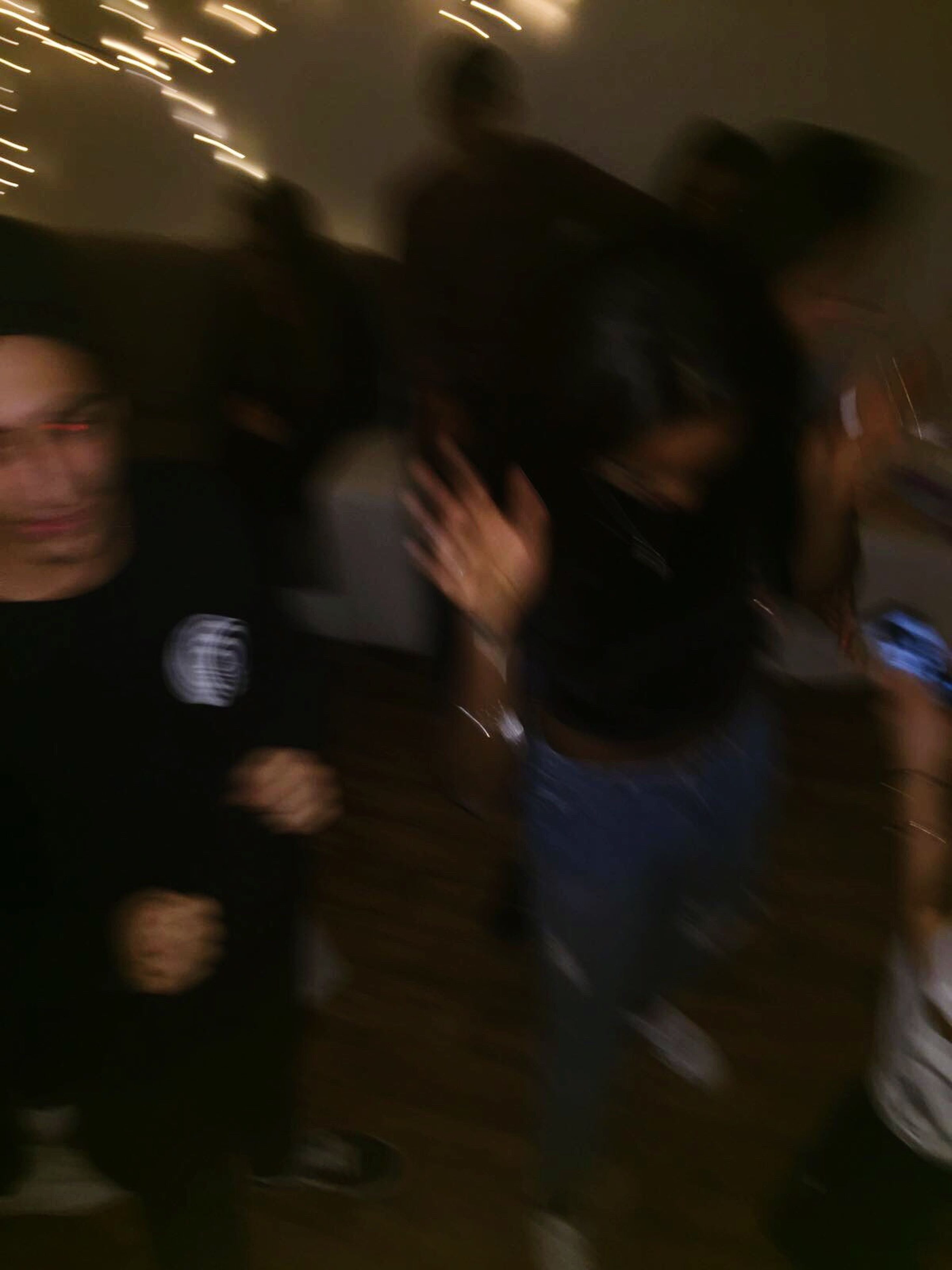 blurred motion, lifestyles, one person, real people, motion, adults only, women, indoors, urgency, leisure activity, adult, people, men, only women, close-up, day