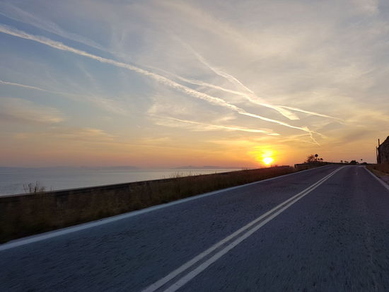 riding sunset Sunset Road Sun Transportation Scenics Cloud - Sky The Way Forward Landscape Sky Outdoors Sunlight No People Horizon Trip Sounio Sunion Greece