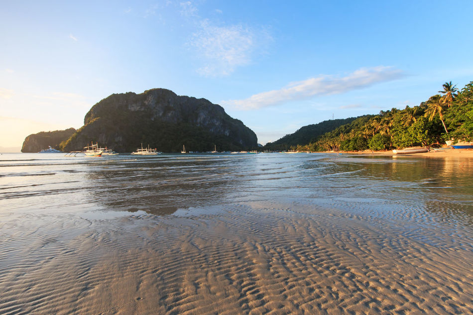 Sunset at Corong Corong beach, El Nido, Palawan in the Philippines ASIA Beach Beauty In Nature Coastline Corong Corong El Nido Mountain Nacpan Nature Non-urban Scene Palawan Philippines Puerto Princesa Sand Scenics Sea Shore Sky South East Asia Summer Tranquil Scene Tranquility Tropics Underground River Water