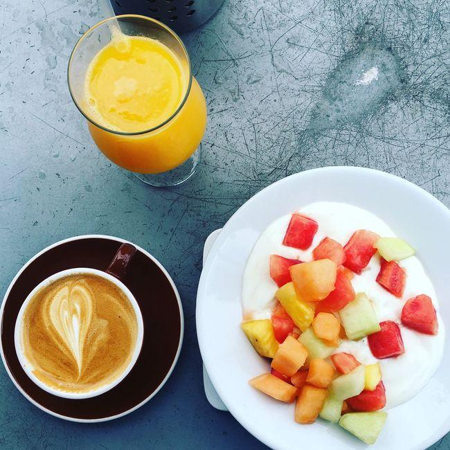 Yogurt, fruit, OJ and coffee Food Coffee