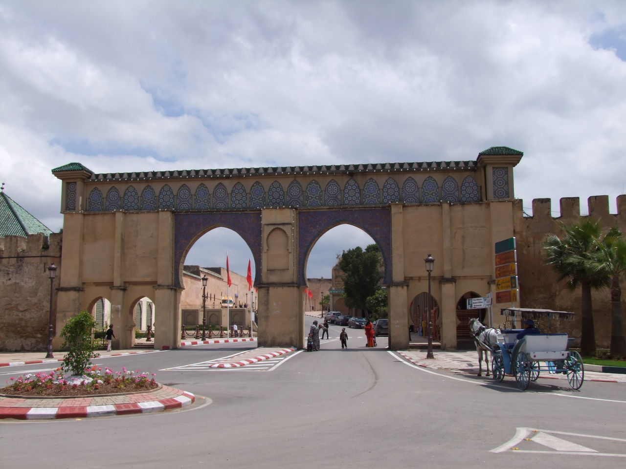 Historic Gateway Arches Architecture City Composition Entrance Entrance Gate Famous Place Gateway Historical Building Historical Place Horse And Carriage Main Entrance Meknès Moroccan Architecture Moroccan Style Morocco No People Outdoor Photography Road Roundabout Sunlight And Shade Tourist Attraction  Tourist Destination Tree White Clouds