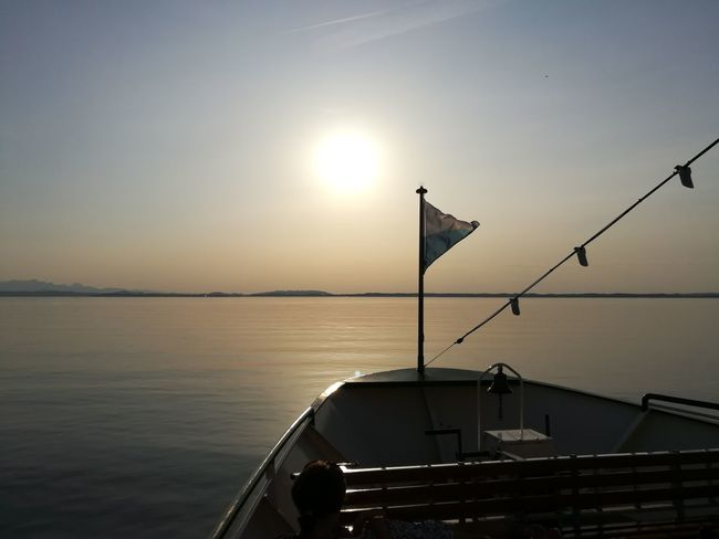 Water Sea Tranquility Sunset No People Reflection Sunlight Horizon Over Water Ship Mountains Lake Chiemsee