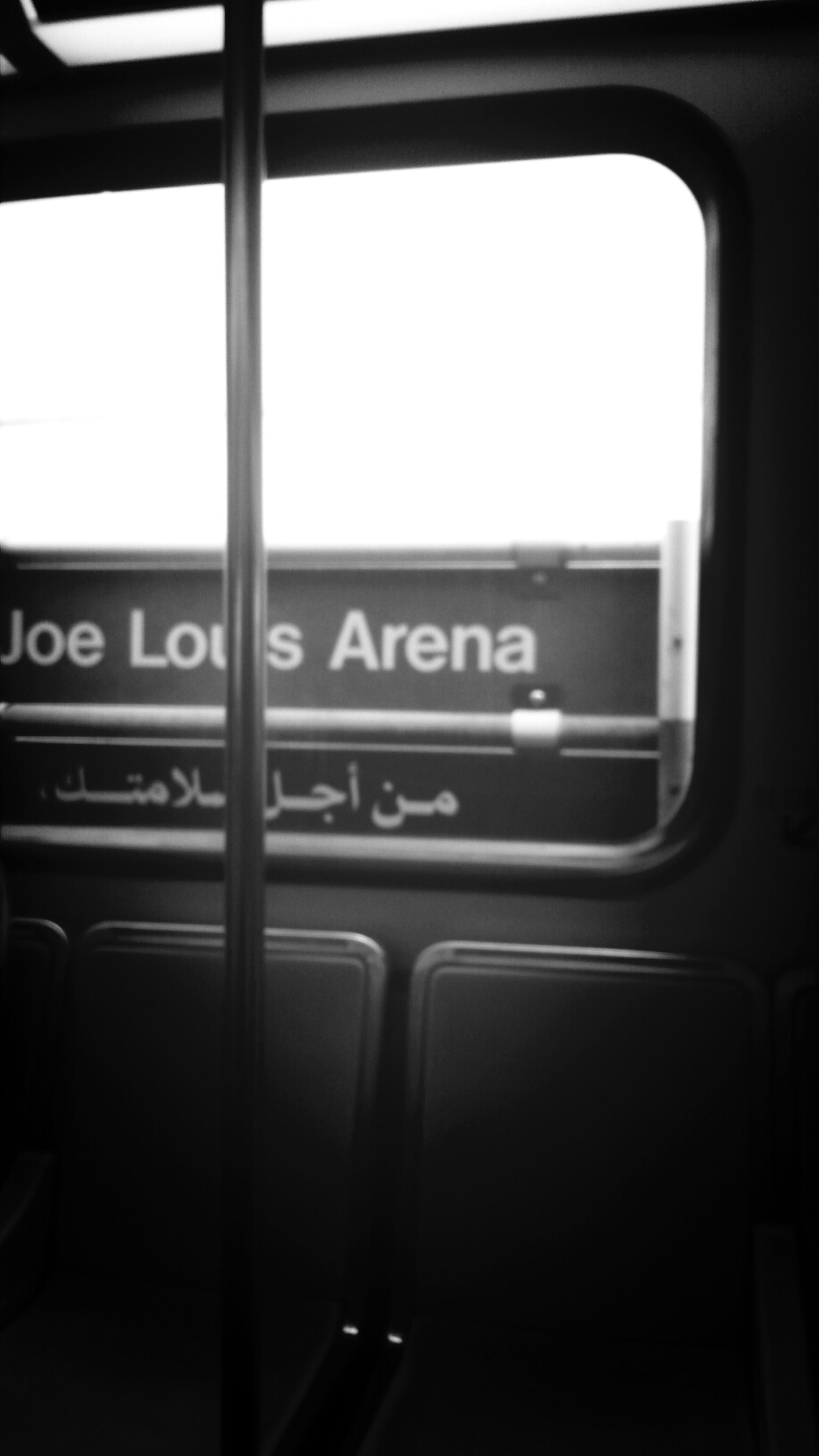 indoors, text, communication, transportation, vehicle interior, western script, window, transparent, glass - material, mode of transport, public transportation, travel, information sign, train - vehicle, car, no people, close-up, rail transportation, day, land vehicle