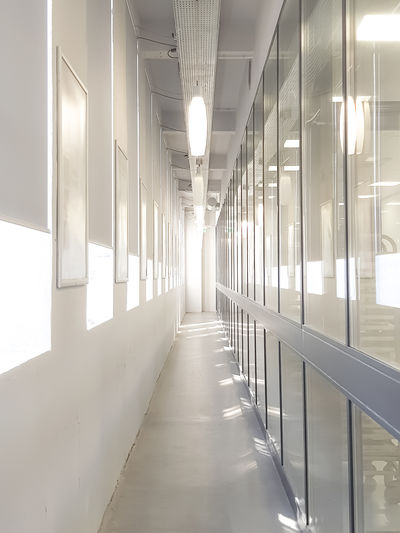 Hallway Light Reflection Architecture Building Building Interior Corridor Day Diminishing Perspective Illuminated Indoors  Light And Shadow Lighting Equipment No People Passage Reflections The Way Forward White White Color