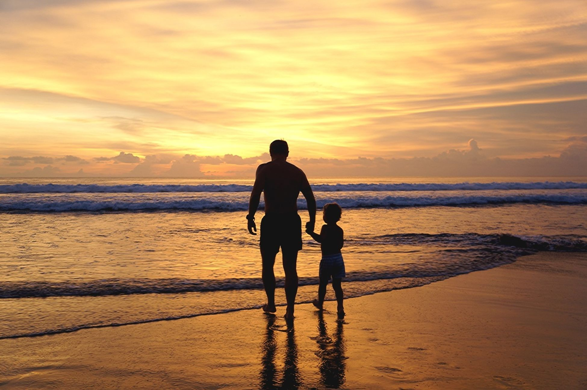 sunset, sea, beach, horizon over water, water, shore, sky, silhouette, lifestyles, leisure activity, scenics, orange color, beauty in nature, sand, men, standing, vacations, tranquil scene