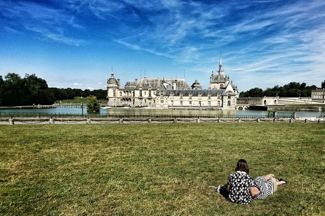 Two Is Better Than One Grass Relaxation Person Building Exterior Tranquility Outdoors Summer Green Color Tranquil Scene Castles Tranquility People And Places