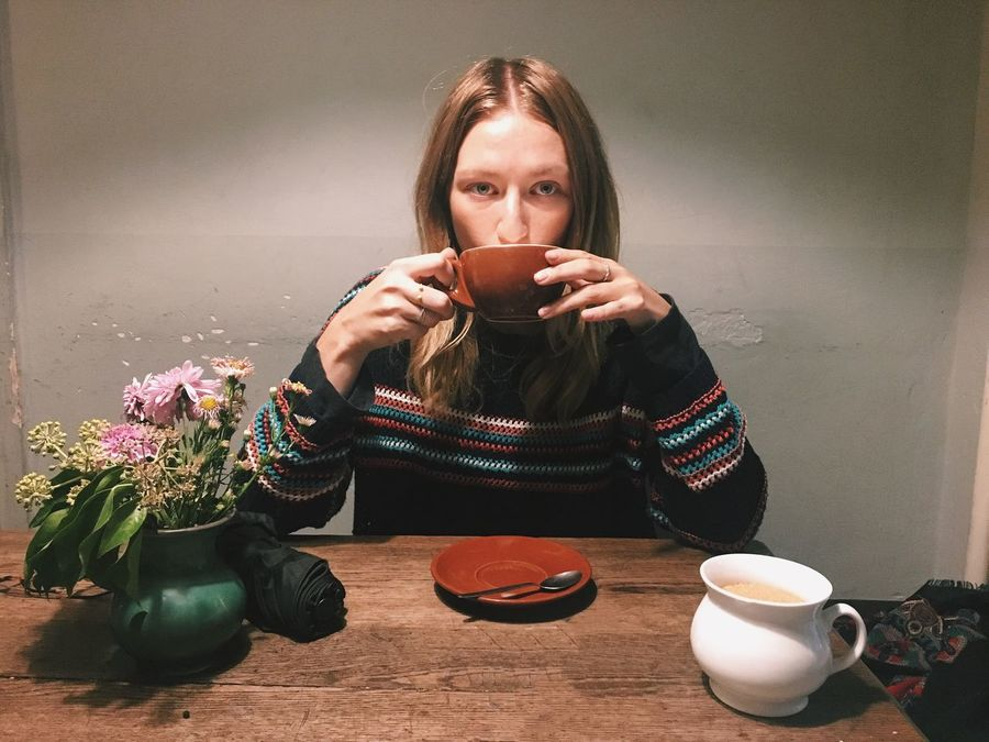 Indoors  Sitting Front View Coffee Drinking Coffee Shop Woman Young Adult