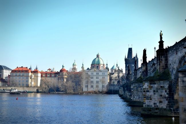Architecture Bridge Building Exterior Built Structure Charles Bridge City Day Historical Building History Outdoors Place Of Worship Prague River River View Sky Statue Sunny Day Tourism Tourist Attraction  Travel Destinations Travel Photography Water Water Reflections