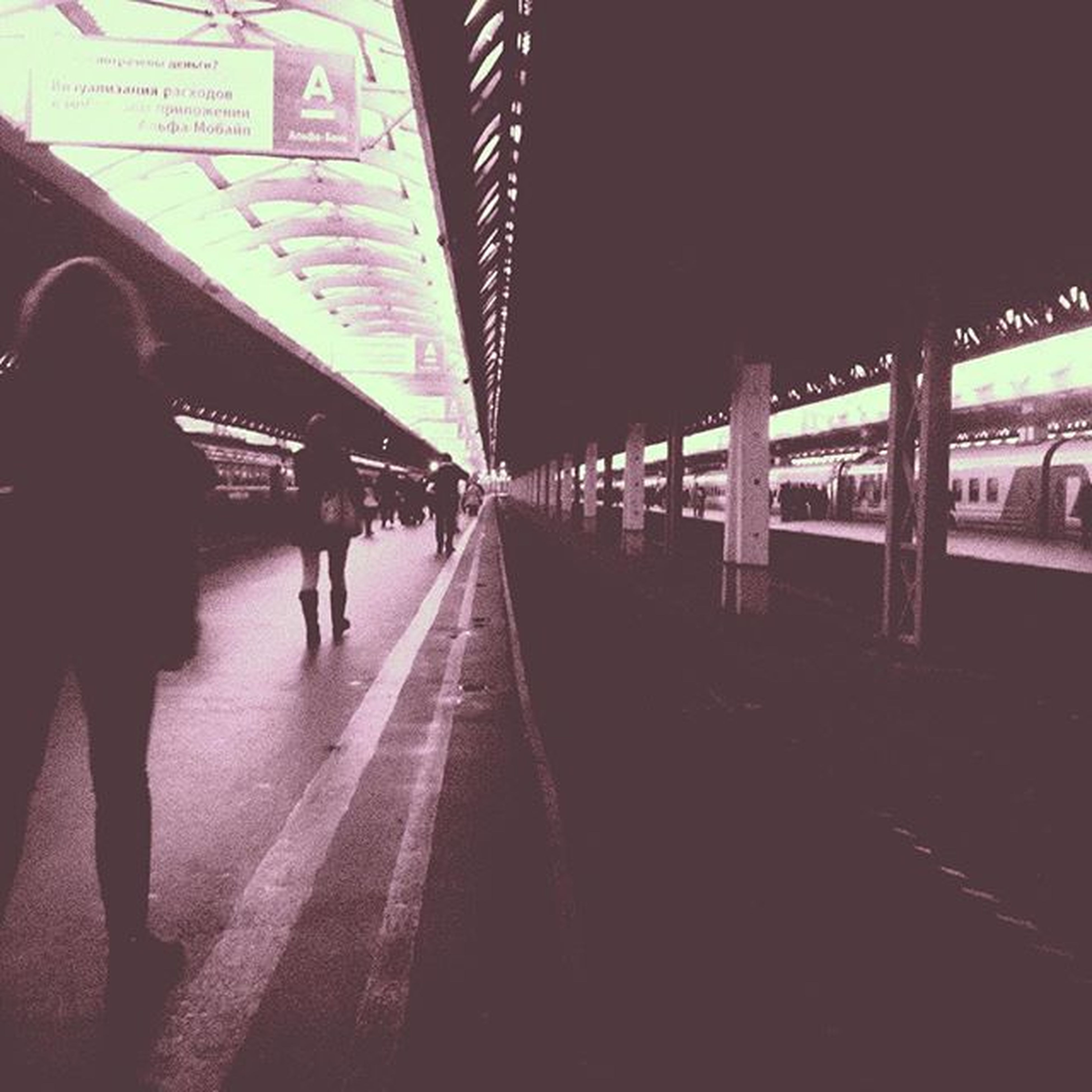 transportation, architecture, built structure, men, walking, lifestyles, person, city life, the way forward, bridge - man made structure, connection, travel, city, mode of transport, railroad station, railroad station platform, public transportation, leisure activity, rear view