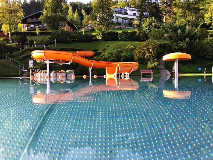 Swimmingpool in Austria - Holiday Holiday POV POV Swimming Pool Water Tree Water Park Built Structure Architecture Day Outdoors No People Building Exterior Water Slide