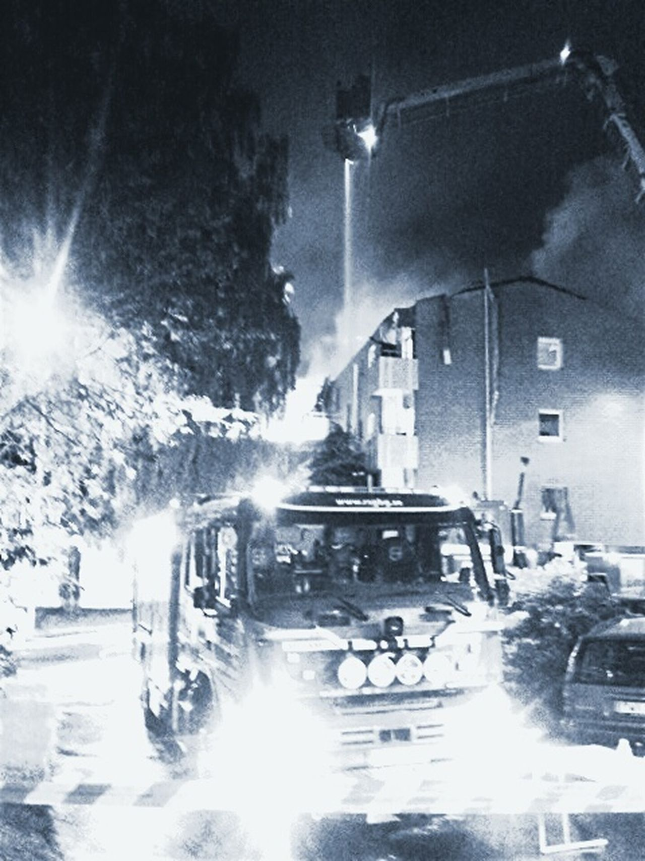 Collected Community Firefighters Extinguishing Fires Fire Truck And Skylift Syncronizing Waterhoseing Black And Withe Fire Alarm Resque Firefighters In Action Hot Summer Night SOS Alarm Building On Fire Black And White Fire Squad At Duty